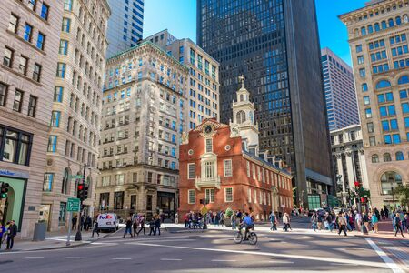 pedestrian: BOSTON, MASSACHUSETTS - OCTOBER 14, 2016: Pedestrians cross at the Old State House in Boston.