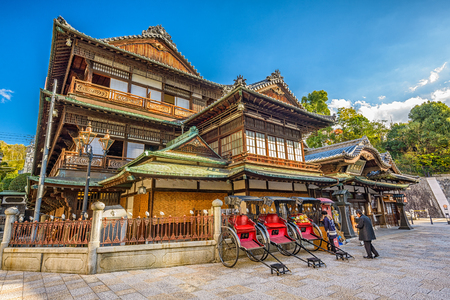 MATSUYAMA, JAPAN - DECEMBER 3, 2012: Workers at Dogo Onsen bath house. It is one of the oldest bath houses in the country. Redakční