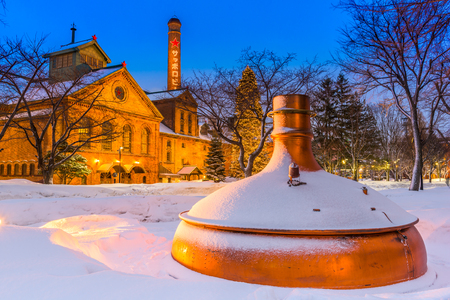 sapporo: SAPPORO, JAPAN - FEBRUARY 17, 2017: Sapporo Beer Museum at night. The building was first opened as Kaitakushi Brewery in 1876. Editorial