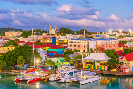 St. Johns, Antigua port and skyline at twilight. Stock Photo