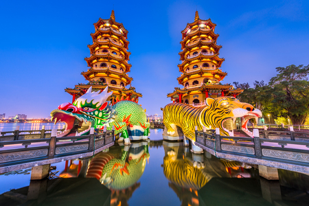 Kaohsiung, Taiwan Lotus Pond's Dragon and Tiger Pagodas at night.