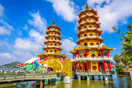 Kaohsiung, Taiwan Lotus Pond's Dragon and Tiger Pagodas at night. Stock Photo - 75762906