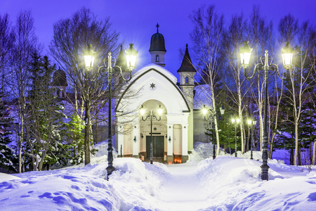 sapporo: ASAHIKAWA, JAPAN - FERUARY 12, 2017: The Snow Crysal Museum at twilight. Housed in a European inspired castle, the museum focuses on the natural wonder of snow and ice.
