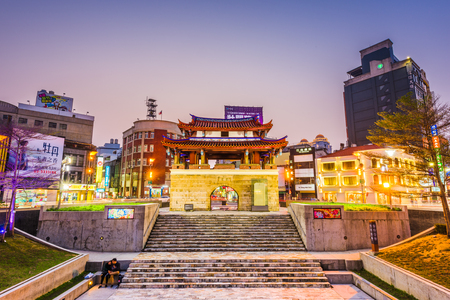 HSINCHU, TAIWAN - MARCH 5, 2017: Downtown Hsinchu cityscape with the Eastern Gate. The gate is the last remaining of Hsinchus historic city wall.