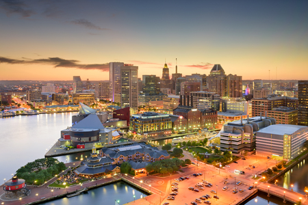 Baltimore, Maryland, USA inner harbor and downtown skyline at dusk. Stock Photo
