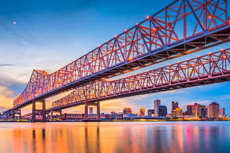 New Orleans, Louisiana, USA at Crescent City Connection Bridge over the Mississippi River. Stock Photo - 80973796