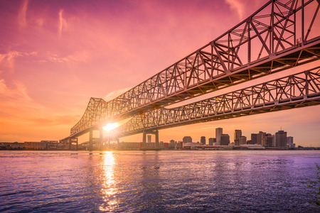 New Orleans, Louisiana, USA at Crescent City Connection Bridge over the Mississippi River during sunset. Stok Fotoğraf