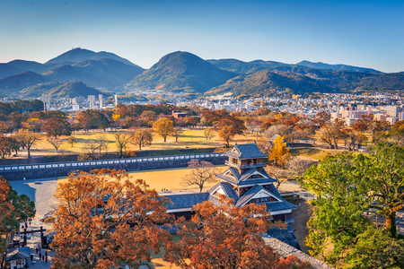 Kumamoto Castle Turret and the landscape of Kumamoto, Japan in autumn.