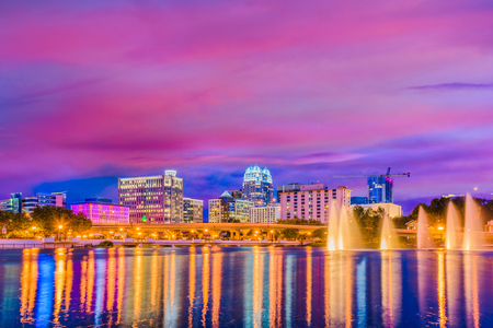 Orlando, Florida, USA skyline on the lake at dusk.