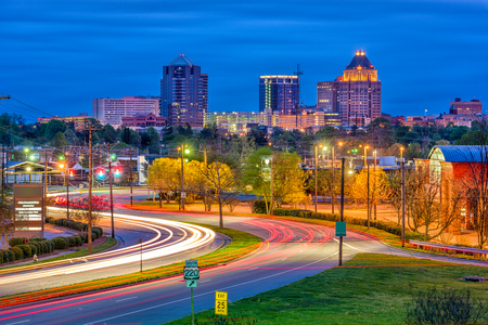 Greensboro, North Carolina, USA downtown skyline and highways.