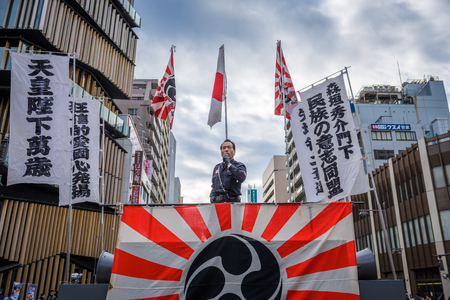 TOKYO - DECEMBER 27, 2015: A right wing speaker gives a public address in the Asakusa district. Though relatively few in number, the right wing groups of Japan are known for highly visible demonstrations.