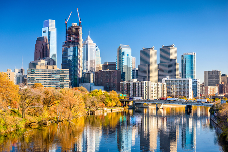 Philadelphia, Pennsylvania, USA downtown skyline on the river in autumn.