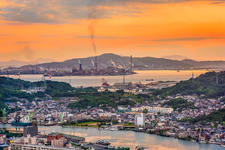 Shimonoseki, Yamaguchi, Japan skyline over the straits with industrial areas. Stock Photo