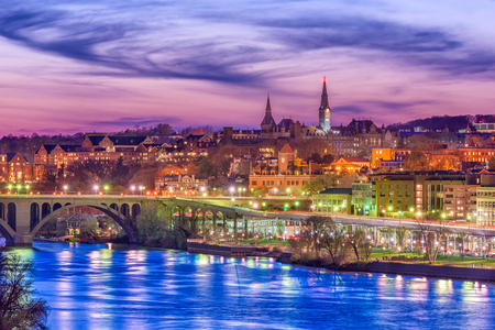 Georgetown, Washington DC, USA skyline on the Potomac River at twilight.