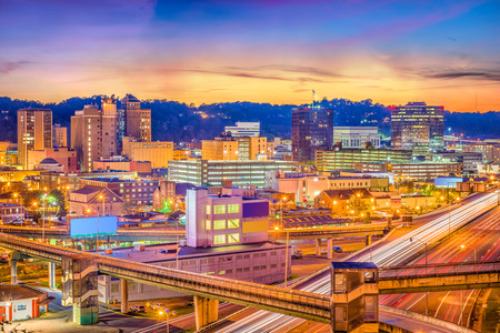 Charleston, West Virginia, USA downtown skyline over the interstate and the river. Stock Photo