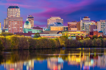Indianapolis, Indiana, USA skyline on the White River with the state capitol building at dusk.