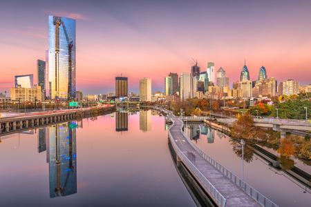 Philadelphia, Pennsylvania, USA downtown city skyline on the Schuylkill River at twilight.