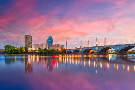 Springfield, Massachusetts, USA downtown skyline on the river at dusk.