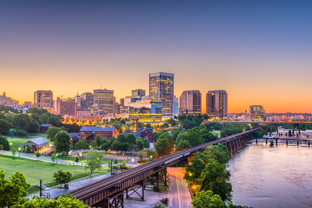 Richmond, Virginia, USA downtown skyline on the river at twilight.