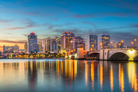 West Palm Beach, Florida, USA skyline on the Intracoastal Waterway at twilight.