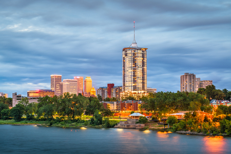 Tulsa, Oklahoma, USA downtown skyline on the Arkansas River at dusk. Stock Photo