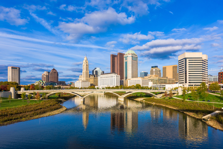 Columbus, Ohio, USA downtown skyline over the Scioto River.