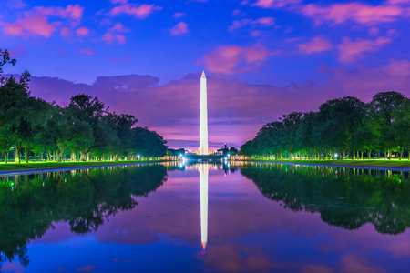 Washington Monument on the Reflecting Pool in Washington, D.C. USA at dawn.
