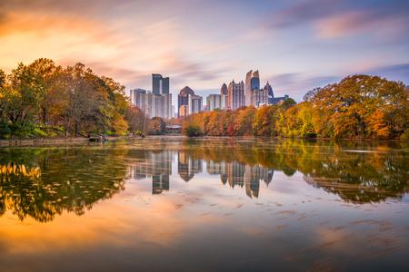 Atlanta, Georgia, USA Piedmont Park skyline in autumn on Lake Meer at dusk.