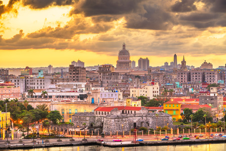 Havana, Cuba downtown skyline over the Malecon waterfront at dusk.