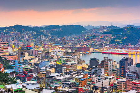 Keelung, Taiwan cityscape and temples at dusk. Stock Photo