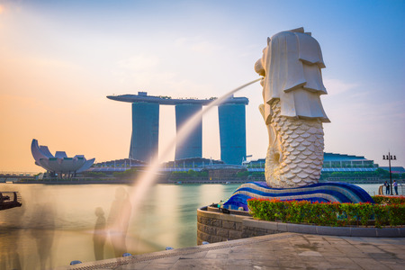 SINGAPORE - SEPTEMBER 3, 2015: The Merlion statue fountain and the Singapore skyline. The landmark statue is considered the personification of Singapore. Editorial