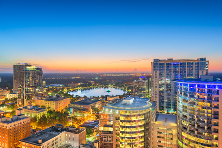 Orlando, Florida, USA aerial skyline towards Lake Eola at dawn.