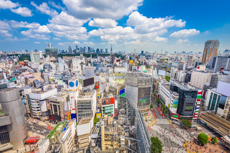 Shibuya, Tokyo, Japan city skyline over Shibuya Scramble Crosswalk in the afternoon.