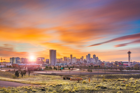 Denver, Colorado, USA downtown city skyline at dawn.