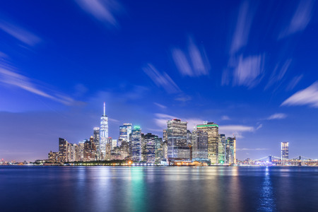 New York, New York, USA skyline on the bay at twilight from Governors Island.