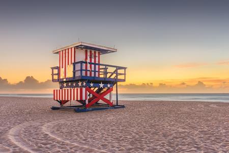 Miami Beach, Florida, USA sunrise and life guard tower.