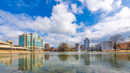 Huntsville, Alabama, USA park and downtown cityscape.