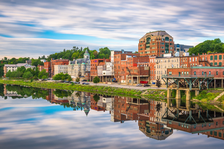 Augusta, Maine, USA downtown skyline and reflection on the Kennebec River.