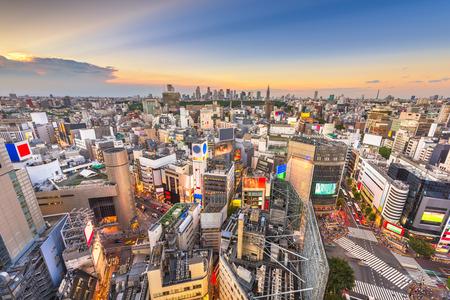Tokyo, Japan city skyline over Shibuya Ward with the Shinjuku skyline in the distance.