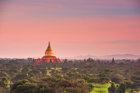Bagan, Myanmar ancient temple ruins landscape with Ananda Temple in the archaeological zone at dusk.