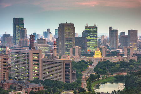 Tokyo, Japan cityscape over Chiyoda Ward with the National Diet Building at twilight.