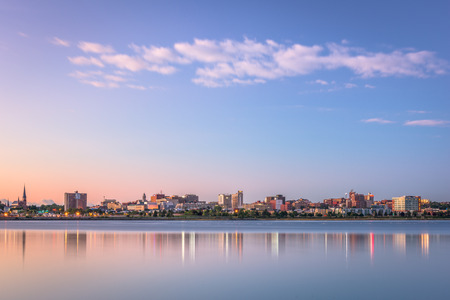 Portland, Maine, USA downtown skyline from Back Cove at dawn.