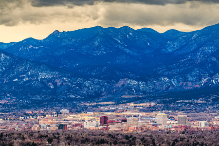 Colorado Springs, Colorado, USA downtown skyline and mountains at dusk. Stock Photo