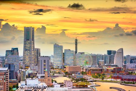 Yokohama, Japan harbor and downtown skyline at dusk.