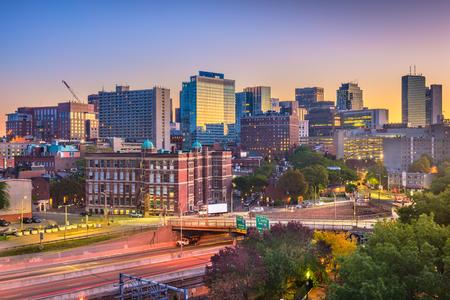 Boston, Massachusetts, USA cityscape over highways at dawn.