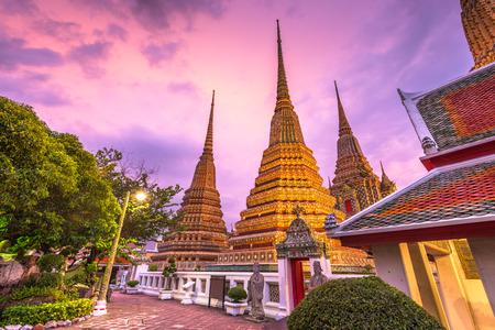 Wat Pho Temple in Bangkok, Thailand at dusk.