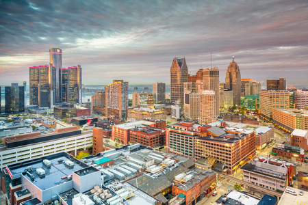 Detroit, Michigan, USA downtown skyline from above at dusk.