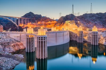 Hooover Dam on the Colorado River straddling Nevada and Arizona at dusk. Stock Photo