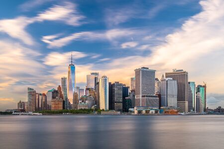 New York, New York, USA skyline on the bay at twilight from Governors Island Stock Photo