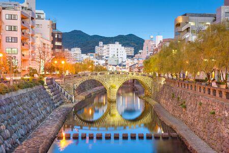 Nagasaki, Japan cityscape with Megane Spectacles Bridge at dusk.